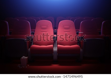 Interior of empty cinema with rows of red seats with cup holders and popcorn. Concept of entertainment. 3d rendering toned image