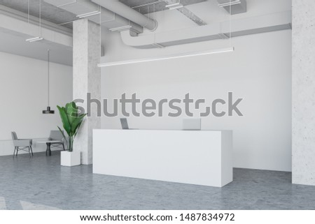 Interior of empty industrial style office with white walls, concrete floor, white reception desk and waiting room area with round table and comfortable armchairs. 3d rendering