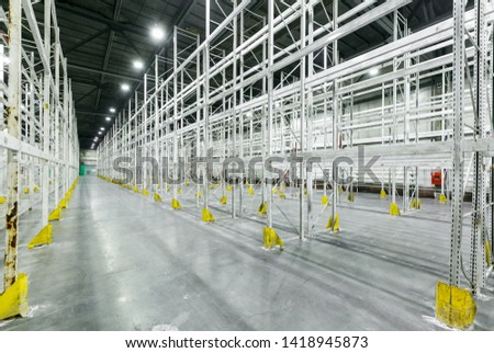 Interior of empty warehouse with empty racks	 #1418945873