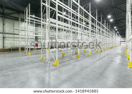 Interior of empty warehouse with empty racks