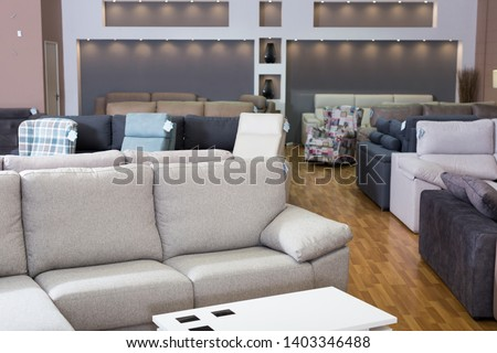 Interior of furniture salon shopping room with sofas
