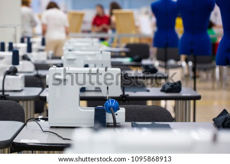 interior of garment factory shop. Closes making atelier with several sewing machines. Tailoring industry. #1095868913