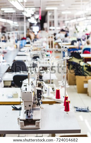 Interior of garment factory shop. Closes making atelier with several sewing machines. Tailoring industry, fashion designer workshop, industry concept #724014682