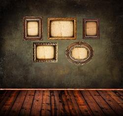 Interior of grunge empty room with antique golden frames