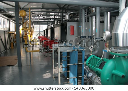 Interior of a modern hi-tech gas boiler-house with industrial ...