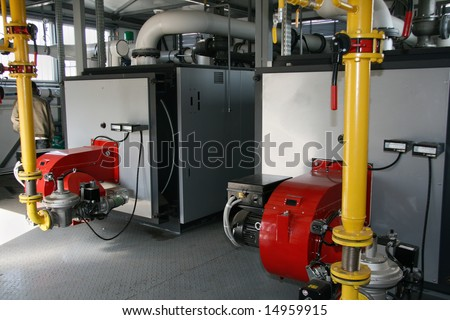 Interior of independent modern gas boiler-house with two steel ...