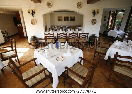 Interior Of Italian Restaurant With White Table Cloths Stock Photo