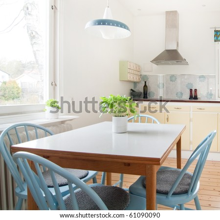 interior of kitchen with a table and basil
