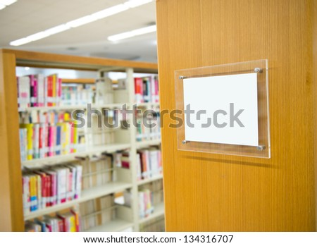 Interior of library with book shelves and books.