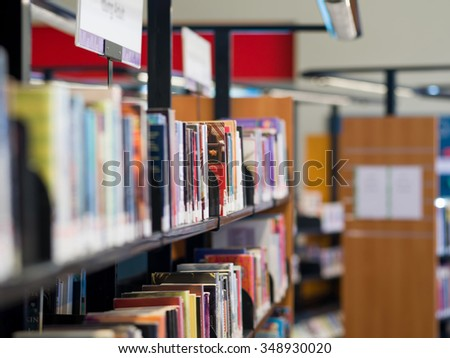 Interior of library with book shelves with books #348930020