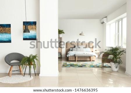 Interior of light modern studio apartment #1476636395