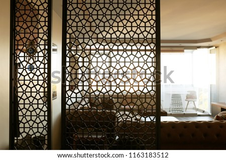 Interior of living room, view through decorative room divider