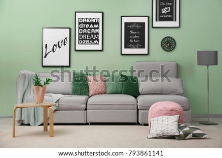 Interior of living room with comfortable sofa #793861141