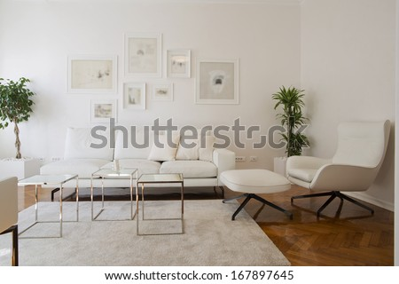 Interior of living room with white furniture