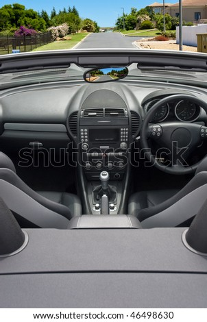 Interior of luxury convertible car in the road