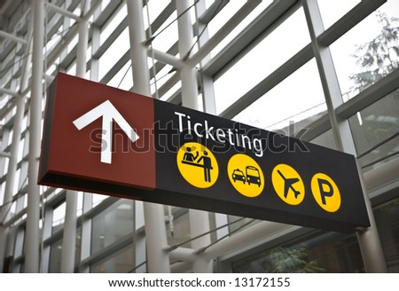 Interior of main terminal at Sea-Tac (Seattle) airport with closeup of ticketing direction sign