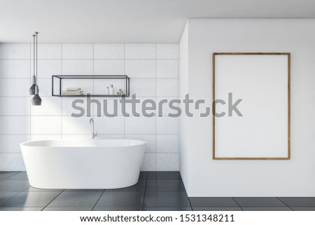 Interior of minimalistic bathroom with white tile walls, gray floor, comfortable bathtub, vertical mock up poster and shelves with beauty products. 3d rendering