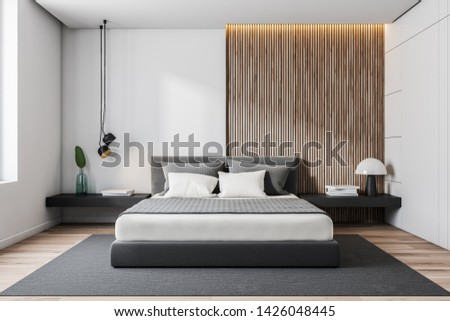 Interior of minimalistic bedroom with white and wooden walls, wooden floor, gray master bed with black bedside tables and gray carpet. 3d rendering