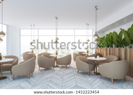 Interior of minimalistic cafe with white walls, wooden floor, panoramic windows, beige armchairs standing near round tables and wooden flower beds. 3d rendering