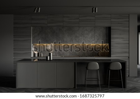 Interior of minimalistic kitchen with grey walls, dark wooden floor, comfortable bar with stools, wooden countertops and grey cupboards above them. 3d rendering