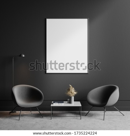 Interior of minimalistic living room with dark grey walls, concrete floor, two cozy gray armchairs standing near square coffee table with vertical mock up poster above it. 3d rendering