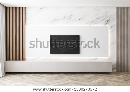 Interior of minimalistic living room with marble and wooden walls, wooden floor and modern flat screen TV. Concept of home entertainment system and technology. 3d rendering
