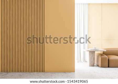 Interior of minimalistic living room with yellow walls, stone floor, comfortable leather sofa and wooden coffee table. 3d rendering