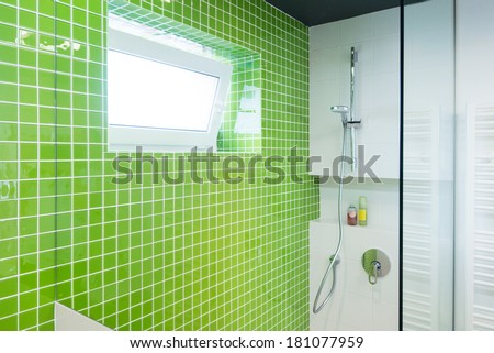 interior of modern bathroom with green tiles