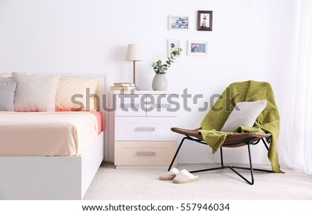 Interior of modern bedroom with cozy double bed #557946034