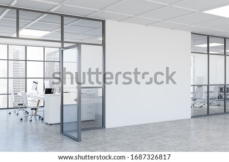 Interior of modern business center hall with white and glass walls, concrete floor, open space office and conference room. Mock up wall between them. 3d rendering