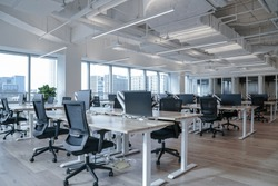 Interior of modern empty office building.Open ceiling design.