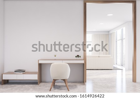 Interior of modern home office with white walls, wooden floor, wooden table with white armchair and living room in background. 3d rendering Сток-фото ©