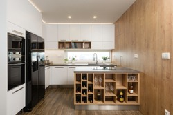 Interior of modern kitchen with built-in appliances