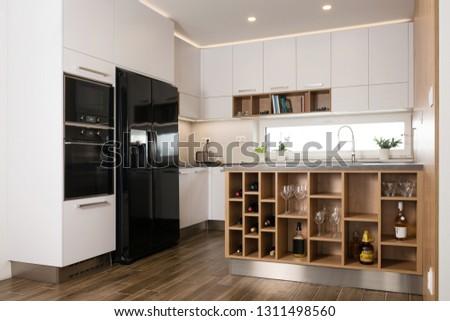 Interior of modern kitchen with built-in appliances #1311498560