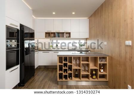 Interior of modern kitchen with built-in appliances #1314310274