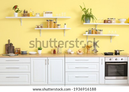 Interior of modern kitchen with shelves