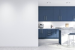 Interior of modern kitchen with white walls, concrete floor, blue countertops and cupboards, marble bar with stools and white mock up wall on the left. 3d rendering