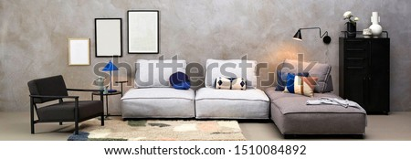 Interior of modern living room with sofa and furniture .