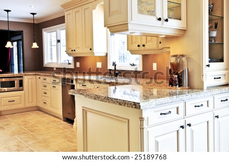 Interior of modern luxury kitchen with granite countertop - stock photo