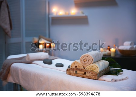Interior of modern massage room in candle light Stock photo ©