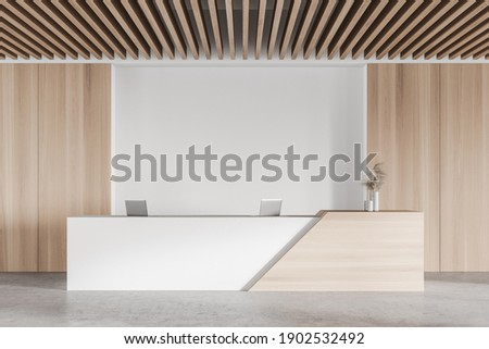 Interior of modern office waiting room with white and wooden walls, concrete floor and reception desk. 3d rendering Stock photo ©