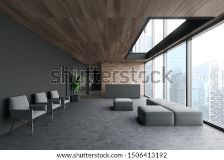 Interior of modern office with gray and wooden walls, concrete floor, grey reception table with laptop, sofa and row of armchairs for visitors. 3d rendering