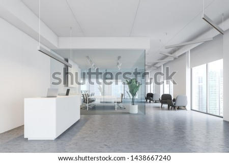 Interior of modern office with white walls, concrete floor, white reception table, meeting room with glass walls and lounge with armchairs. 3d rendering