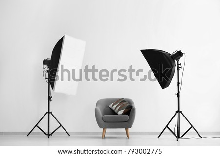 Interior of modern photo studio with armchair and professional equipment #793002775