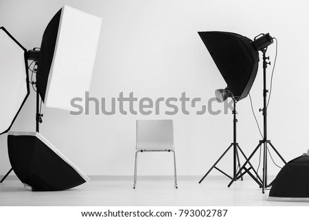 Interior of modern photo studio with chair and professional equipment #793002787