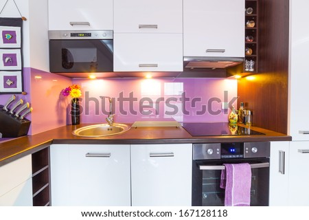Interior of modern white and purple kitchen