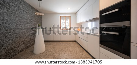 Interior of modern white kitchen with marble and mountain view. Nobody inside #1383941705