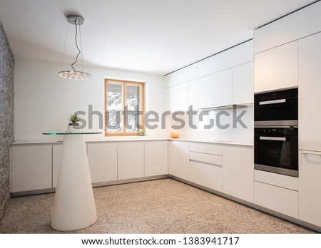 Interior of modern white kitchen with marble and mountain view. Nobody inside #1383941717