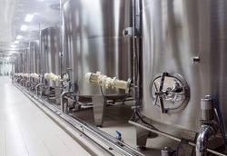Interior of modern winery with stainless equipment under temerature control