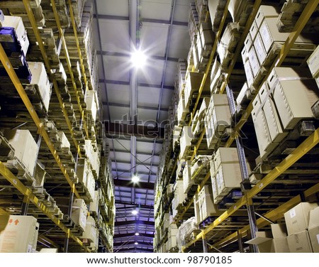 Interior of new and modern warehouse space in well lit large room - stock photo